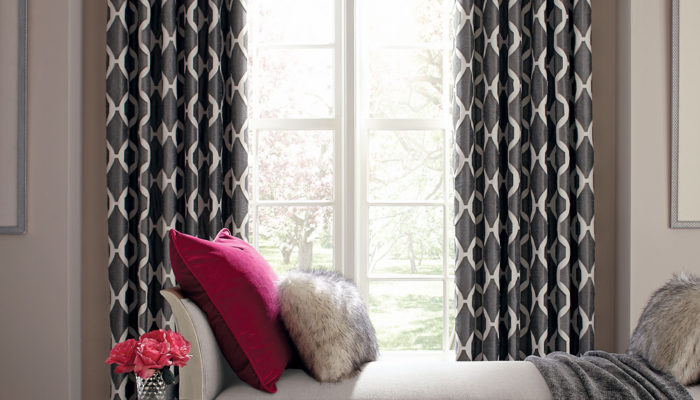This Is A Picture Of A Living Room With Gray And White Patterned Curtains On The Windows.